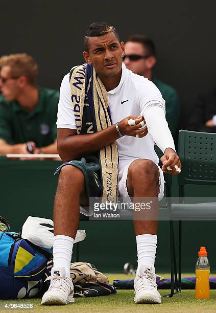Nick Kyrgios of Australia looks on during a break in play in his Gentlemen's Singles Fourth Round match against Richard Gasquet of France during day...