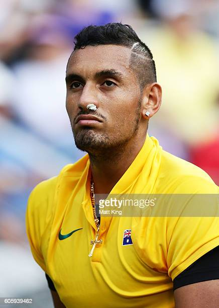 Nick Kyrgios of Australia looks on with his nose plugged due to a nose bleed in his singles match against Andrej Martin of Slovakia during the Davis...