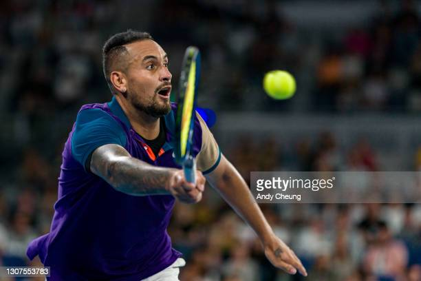 Nick Kyrgios of Australia lunges to play a forehand in his Men's Singles third round match against Dominic Thiem of Austria during day five of the...