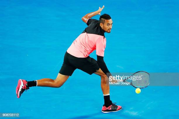 Nick Kyrgios of Australia plays a backhand against Grigor Dimitrov of Bulgaria in his fourth round match against Nick Kyrgios of Australia on day...