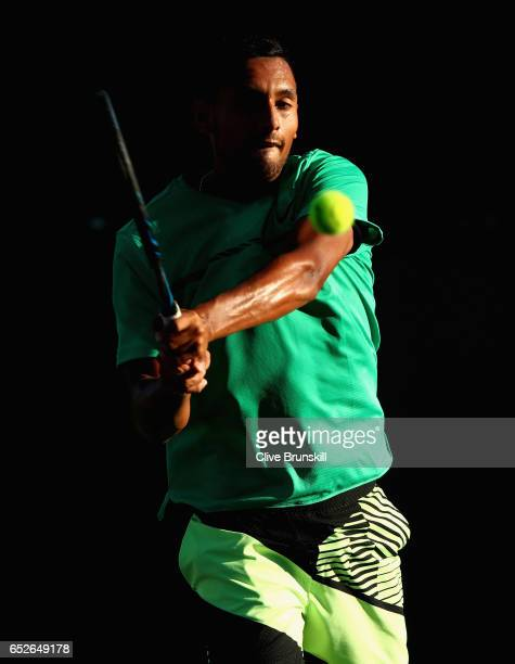 Nick Kyrgios of Australia plays a backhand against Horacio Zeballos of Argentia in their second round match during day seven of the BNP Paribas Open...