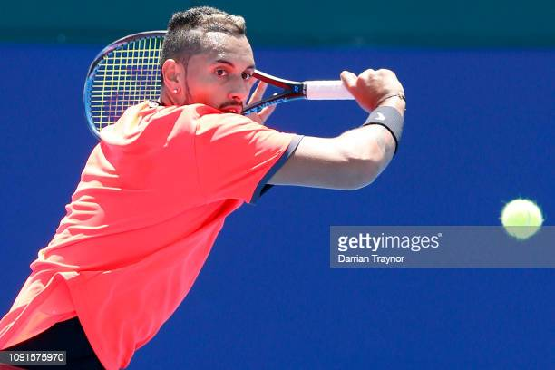 Nick Kyrgios of Australia plays a backhand in his match against Bernard Tomic of Australia during day two of the 2019 Kooyong Classic at the Kooyong...