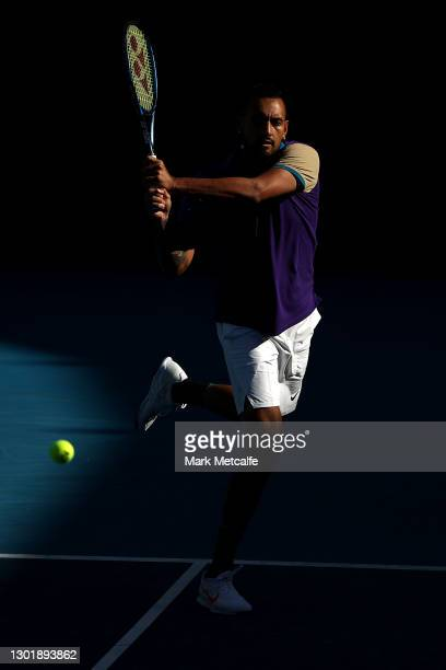 Nick Kyrgios of Australia plays a backhand in his Men's Doubles second round match with partner Thanasi Kokkinakis of Australia against Lloyd Harris...