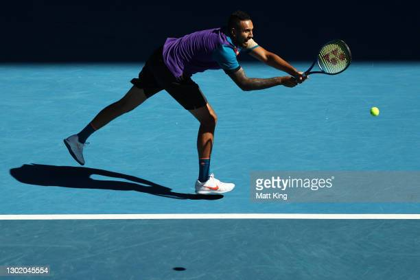 Nick Kyrgios of Australia plays a backhand in his Men's Doubles second round match with partner Thanasi Kokkinakis of Australia against Wesley...
