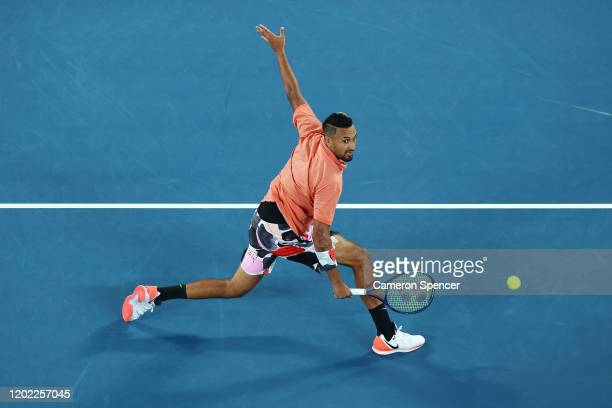 Nick Kyrgios of Australia plays a backhand in his Men's Singles fourth round match against Rafael Nadal of Spain on day eight of the 2020 Australian...