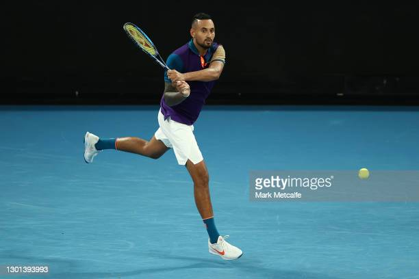 Nick Kyrgios of Australia plays a backhand in his Men's Singles second round match against Ugo Humbert of France during day three of the 2021...