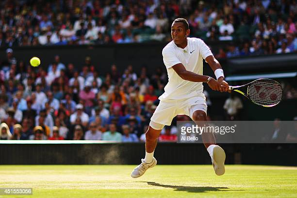 Nick Kyrgios of Australia plays a backhand return during his Gentlemen's Singles fourth round match against Rafael Nadal of Spain on day eight of the...