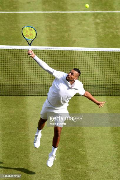 Nick Kyrgios of Australia plays a backhand volley in his Men's Singles second round match against Rafael Nadal of Spain during Day four of The...