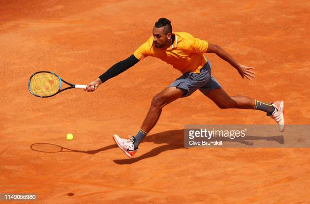 Nick Kyrgios of Australia plays a forehand against Daniil Medvedev of Russia in their first round match during day three of the International BNL...