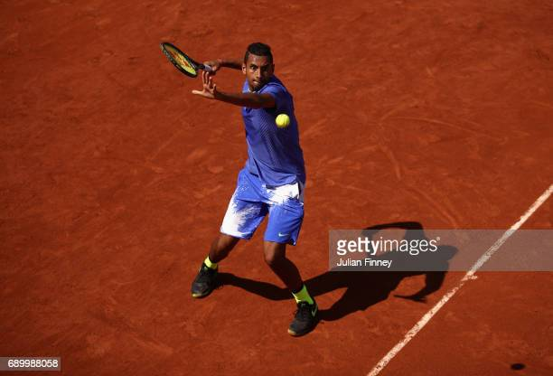 Nick Kyrgios of Australia plays a forehand during the mens singles first round match against Philipp Kohlschreiber of Germany on day three of the...