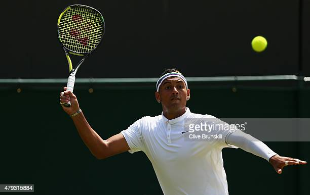 Nick Kyrgios of Australia plays a forehand in his Gentlemen's Singles Third Round match against Milos Raonic of Canada during day five of the...