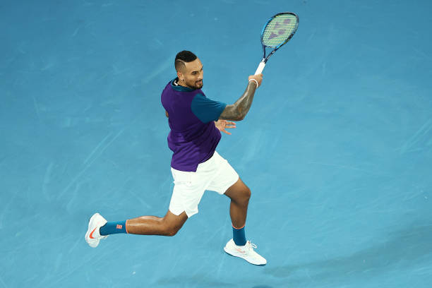 Nick Kyrgios of Australia plays a forehand in his Men's Singles second round match against Ugo Humbert of France during day three of the 2021...