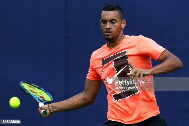 Nick Kyrgios of Australia plays a forehand shot during a practice session ahead of the Aegon Championships at Queens Club on June 16 2017 in London...