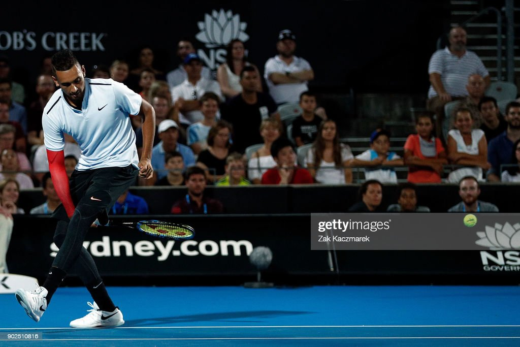 Nick Kyrgios of Australia plays a shot between his legs during a Fast Fours Exhibtion doubles match against Alexander Zverev of Germany and Grigor Dimitrov of Bulgaria during day two of the 2018 Sydney International at Sydney Olympic Park Tennis Centre on January 8, 2018 in Sydney, Australia.