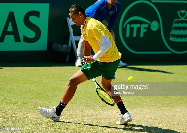 Nick Kyrgios of Australia plays a shot between hs legs in his singles match against Aleksandr Nedovyesov of Kazakhstan during day one of the Davis...