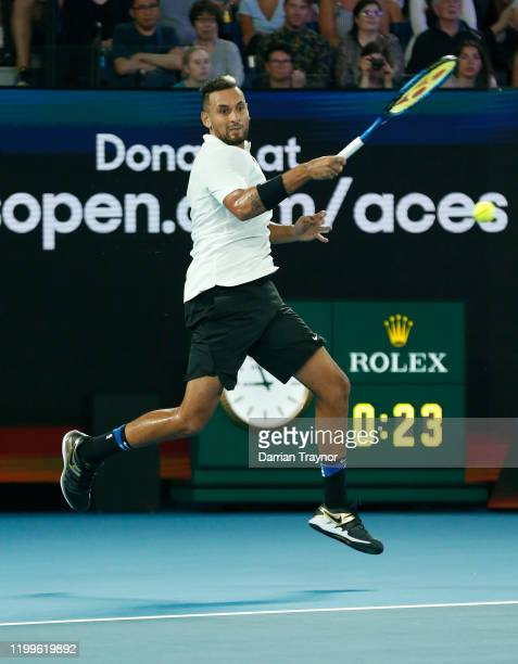 Nick Kyrgios of Australia plays a shot during the Rally for Relief Bushfire Appeal event at Rod Laver Arena on January 15 2020 in Melbourne Australia