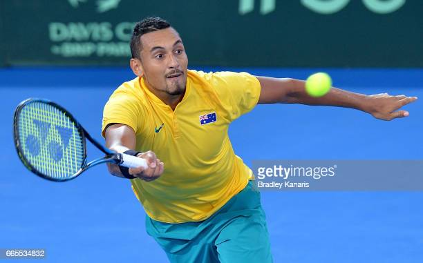 Nick Kyrgios of Australia plays a shot in his match against John Isner of the USA during the Davis Cup World Group Quarterfinals between Australia...