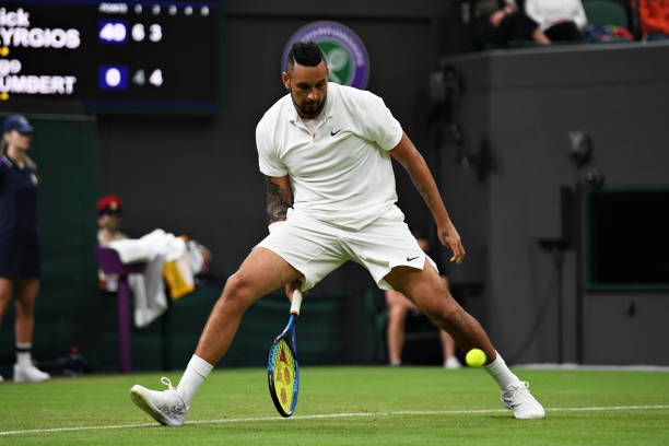 Nick Kyrgios of Australia plays a shot through his legs in his Men's Singles First Round match against Ugo Humbert of France during Day Two of The...