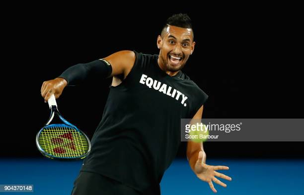 Nick Kyrgios of Australia plays a shot while wearing an Equality shirt during a practice session ahead of the 2018 Australian Open at Melbourne Park...