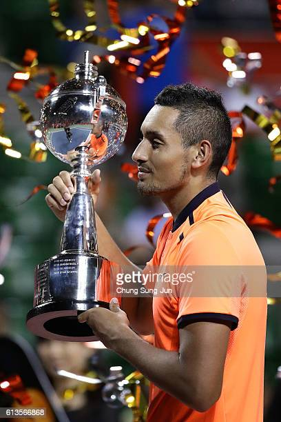 Nick Kyrgios of Australia poses with a trophy after winning the men's singles final match against David Goffin of Belgium on day seven of Rakuten...