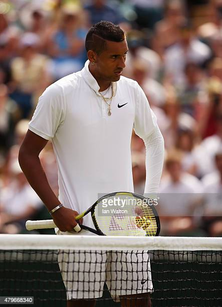 Nick Kyrgios of Australia reacts after defeat in his Gentlemen's Singles Fourth Round match against Richard Gasquet of France during day seven of the...