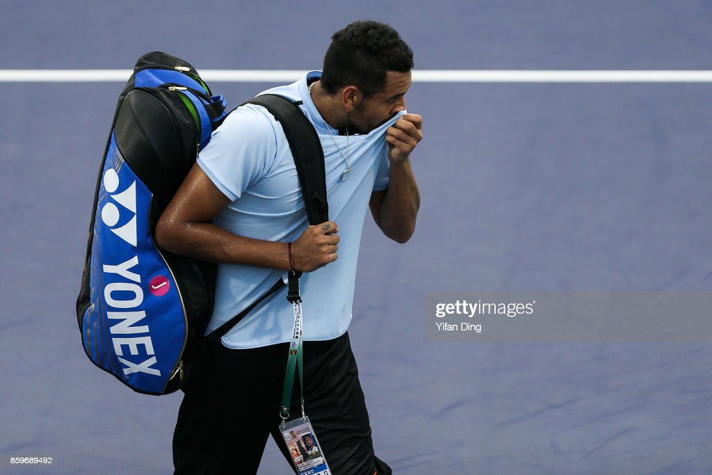 Nick Kyrgios of Australia reacts after retiring from the Men's singles mach against Steve Johnson of United States on day 3 of Shanghai Rolex Masters at Qi Zhong Tennis Centre on October 10, 2017 in Shanghai, China.