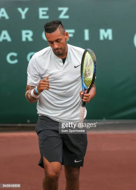 Nick Kyrgios of Australia reacts after winning a point in the match against Ivo Karlovic of Croatia during the Quarterfinal round of the Men's Clay...