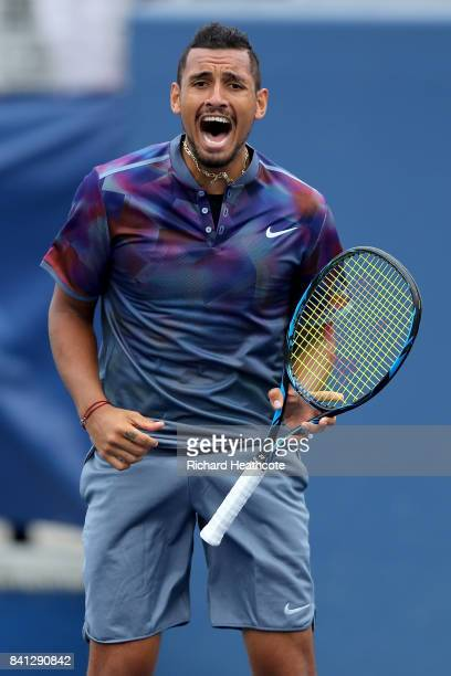 Nick Kyrgios of Australia reacts against Joao Sousa of Portugal and JanLennard Struff of Germany during their first round Men's Doubles match on Day...