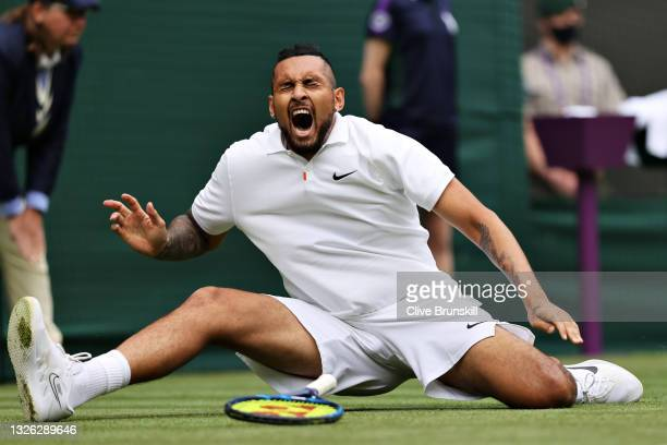 Nick Kyrgios of Australia reacts as he slips over in his Men's Singles First Round match against Ugo Humbert of France during Day Three of The...