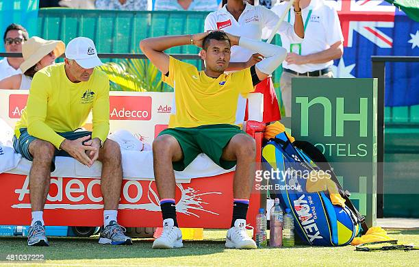 Nick Kyrgios of Australia reacts as Wally Masur captain of Australia talks to him in his match against Aleksandr Nedovyesov of Kazakhstan during day...