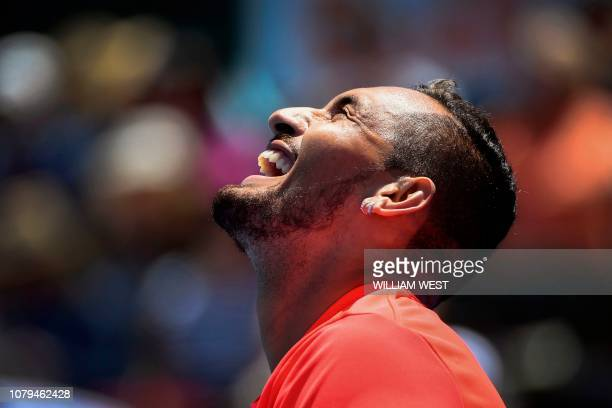 Nick Kyrgios of Australia reacts during his match with compatriot Bernard Tomic on the second day of the Kooyong Classic tennis tournament in...