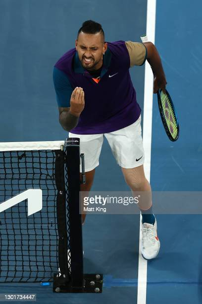 Nick Kyrgios of Australia reacts in his Men's Singles third round match against Dominic Thiem of Austria during day five of the 2021 Australian Open...