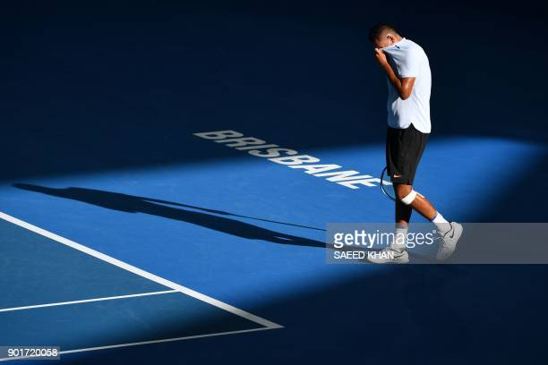 Nick Kyrgios of Australia reacts to a point against Grigor Dimitrov of Bulgaria during their men's singles semifinal match at the Brisbane...
