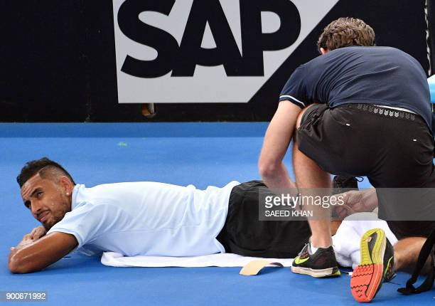 Nick Kyrgios of Australia receives medical assistance during a break against Matthew Ebden of Australia in their round of 16 match at the Brisbane...