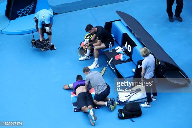 Nick Kyrgios of Australia receives medical treatment in his Men's Doubles second round match with partner Thanasi Kokkinakis of Australia against...