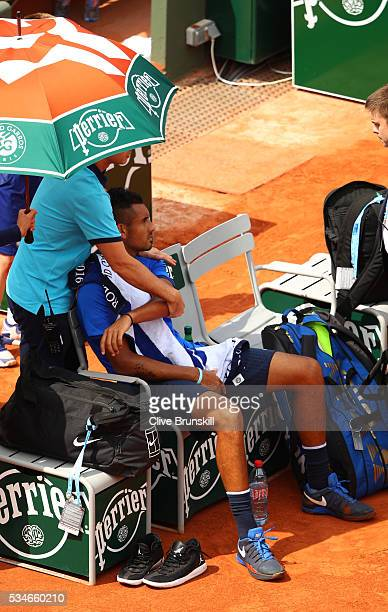 Nick Kyrgios of Australia receives treatment during the Men's Singles third round match against Richard Gasquet of France on day six of the 2016...
