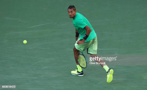 Nick Kyrgios of Australia returns a ball through his legs against Novak Djokovic of Serbia in their fourth round match during day ten of the BNP...