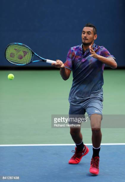 Nick Kyrgios of Australia returns a shot against Joao Sousa of Portugal and JanLennard Struff of Germany during their first round Men's Doubles match...