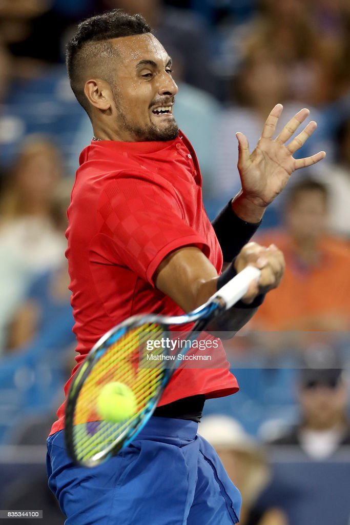 Nick Kyrgios of Australia returns a shot to Rafael Nadal of Spain during day 7 of the Western & Southern Open at the Lindner Family Tennis Center on August 18, 2017 in Mason, Ohio.