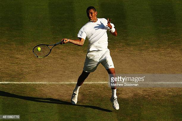Nick Kyrgios of Australia returns during his Gentlemen's Singles fourth round match against Rafael Nadal of Spain on day eight of the Wimbledon Lawn...