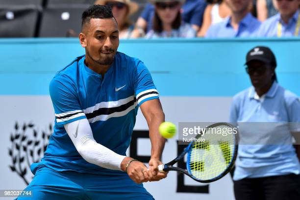 Nick Kyrgios of Australia returns during the semi final singles match on day six of Fever Tree Championships at Queen's Club London on June 23 2018