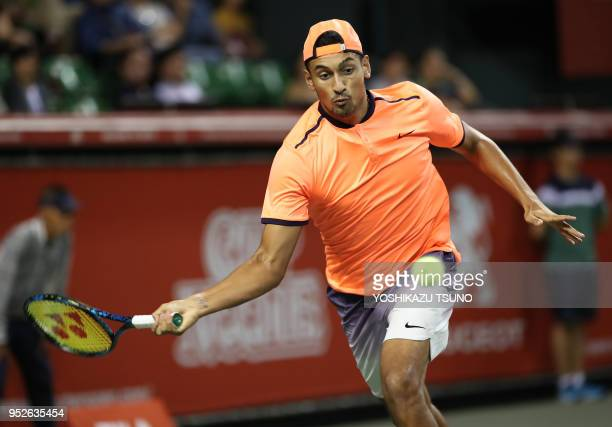 Nick Kyrgios of Australia returns the ball in the final of the Rakuten Japan Open tennis championships in Tokyo on October 9 2016 Kyrgios defeated...