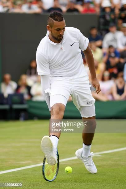 Nick Kyrgios of Australia returns the ball through his legs in his Men's Singles first round match against Jordon Thompson of Australia during Day...