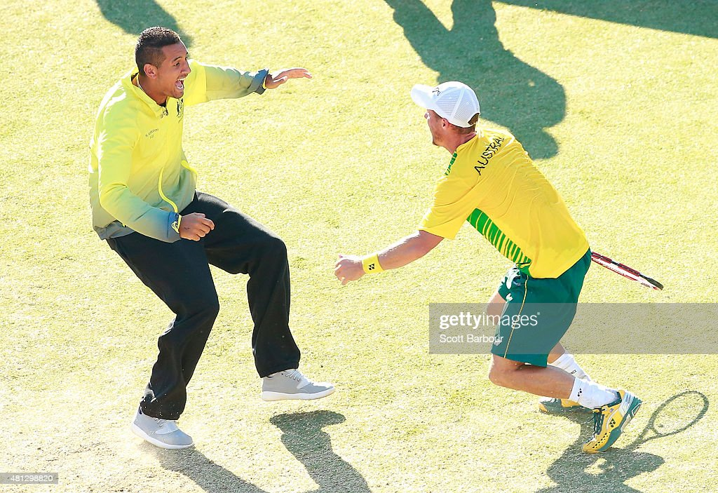 Nick Kyrgios of Australia runs on court to congratulate Lleyton Hewitt of Australia as he celebrates winning the reverse singles match between Lleyton Hewitt of Australia and Aleksandr Nedovyesov of Kazakhstan during day three of the Davis Cup World Group quarterfinal tie between Australia and Kazakhstan at Marrara Sporting Complex on July 19, 2015 in Darwin, Australia.