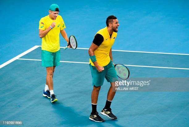 Nick Kyrgios of Australia screams towards the British bench with teammate Alex de Minaur during their men's doubles match against Jamie Murray and...
