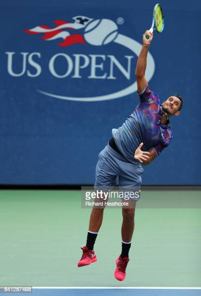 Nick Kyrgios of Australia serves against Joao Sousa of Portugal and JanLennard Struff of Germany during their first round Men's Doubles match on Day...