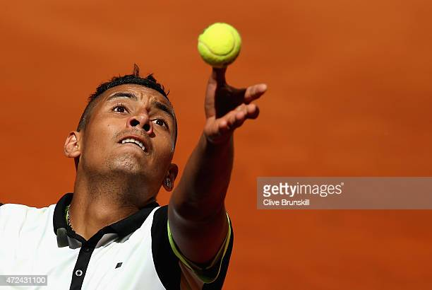 Nick Kyrgios of Australia serves against John Isner of the United States in their third round match during day six of the Mutua Madrid Open tennis...