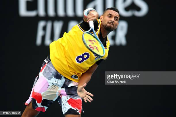 Nick Kyrgios of Australia serves as he warms up wearing a number 8 Kobe Bryant Jersey ahead of his Men's Singles fourth round match against Rafael...