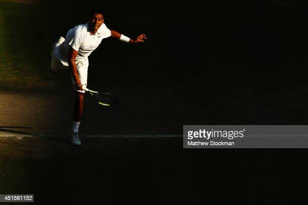 Nick Kyrgios of Australia serves during his Gentlemen's Singles fourth round match against Rafael Nadal of Spain on day eight of the Wimbledon Lawn...