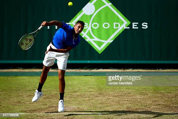 Nick Kyrgios of Australia serves during his match against Alexander Zverev of Germany during day four of The Boodles Tennis Event at Stoke Park on...